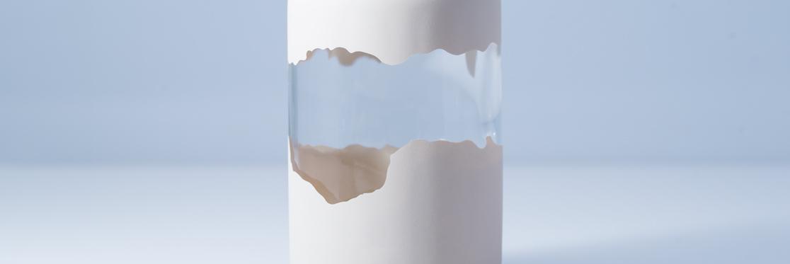 Verniciatura UV con mascheratura su flacone di vetro